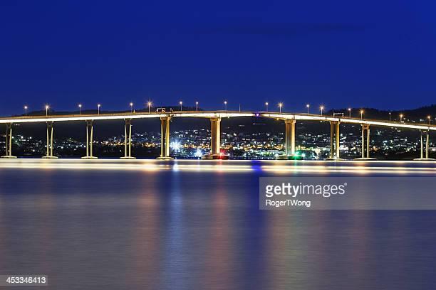 tasman bridge reflections at night - hobart tasmania stock photos and pictures