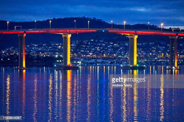 tasman bridge, river derwent, mountain range and city lights at night - housing difficulties stock pictures, royalty-free photos & images