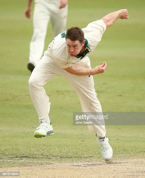 Tasmania bowler Tom Rogers bowls the ball during day three of the Sheffield Shield final match between Queensland and Tasmania at Allan Border Field...