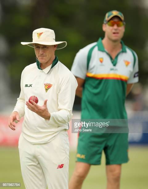Tasmania player George Bailey looks on with coach Adam Griffith during day three of the Sheffield Shield final match between Queensland and Tasmania...