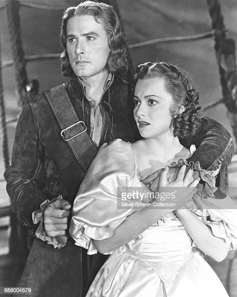Tasmanian-born actor Errol Flynn as physician-turned-pirate Dr. Peter Blood and actress Olivia de Havilland as Arabella Bishop in the swashbuckler...