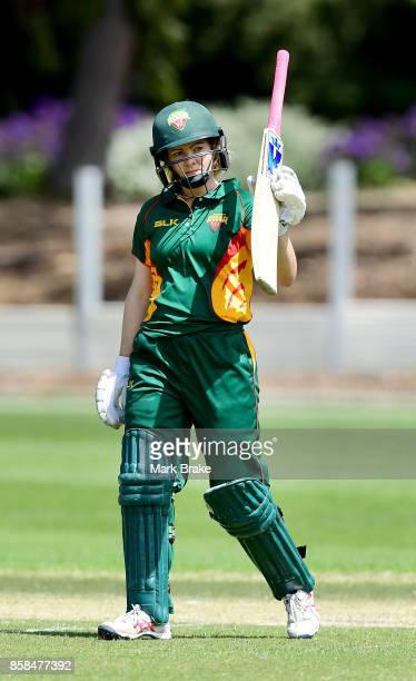 Tasmania's Georgia Redmayne holds her bat up for her 50 during the WNCL match between Tasmania and Western Australia at Adelaide Oval No2 on October...
