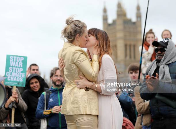 Tasmin and Melissa embrace after they received a blessing ahead of their wedding day surrounded by activists from the climate change group Extinction...