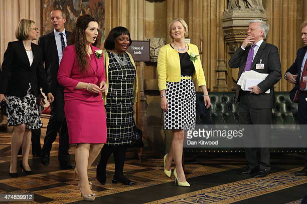 Tasmina AhmedSheikh and Labour MP Dianne Abbott leave through the central lobby with fellow members after the State Opening of Parliament at the...