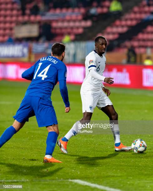 Tasos Bakasetas of Greece vies Glen Kamara of Finland during the UEFA Nations League group stage football match Finland v Grece in Tampere Finland on...