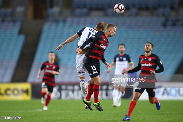 Tass Mourdoukoutas of the Wanderers and Ola Toivonen of the Victory compete for the ball during the round 27 ALeague match between the Western Sydney...