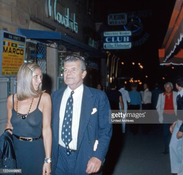 Tassilo Prince of Fuerstenberg talking a walk through the nightlife of Marbella Spain 1981