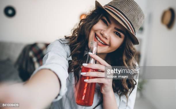 Tasteful red drink from bottle