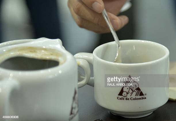 A taster drinks coffee during the Colombian coffee Expoespeciales Cafe de Colombia fair in Medellin Antioquia department Colombia on October 3 2014...