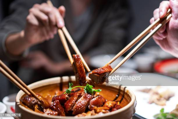 tasting hong kong cuisine - chinese food stock pictures, royalty-free photos & images