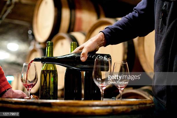 Tasting red wine in a Burgundy winemaker's cellar