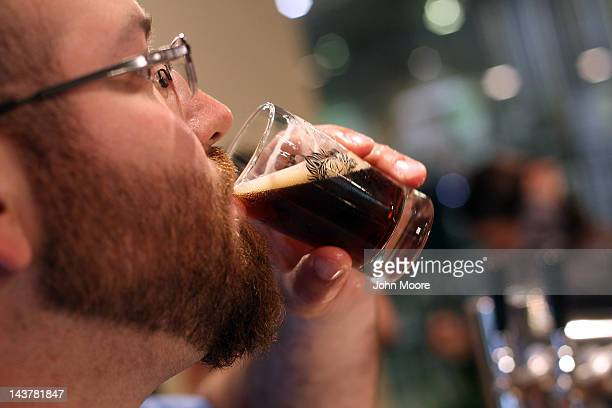 Tasting room manager Aaron Pozit tastes a sample glass of beer at the Captain Lawrence Brewing Company on May 3 2012 in Elmsford New York...