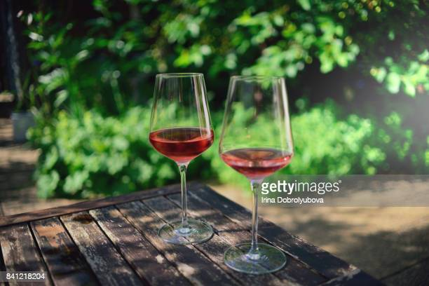 tasting rose wine outdoors - rose colored stock pictures, royalty-free photos & images