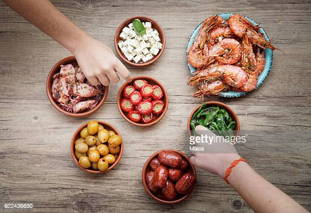 tasting spanish tapas - chorizo stock pictures, royalty-free photos & images
