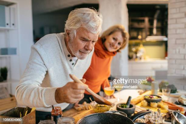 tasting the food they've prepared - hobbies stock pictures, royalty-free photos & images