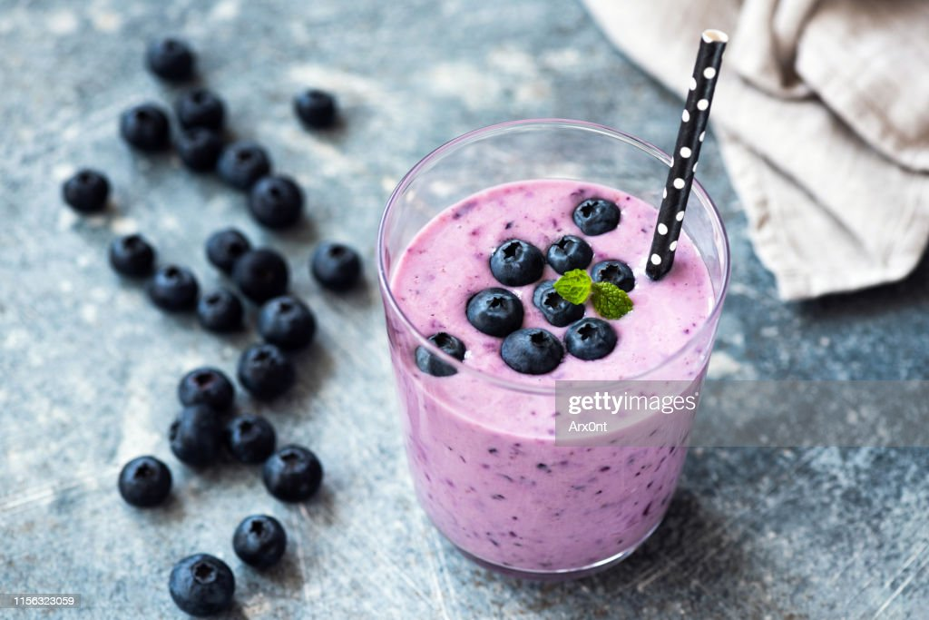 Tasty blueberry smoothie in glass : Stock Photo