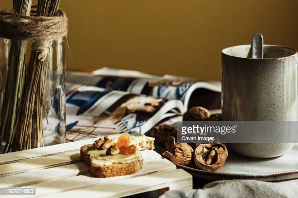 tasty breakfast on table in morning - nuts magazine stock pictures, royalty-free photos & images