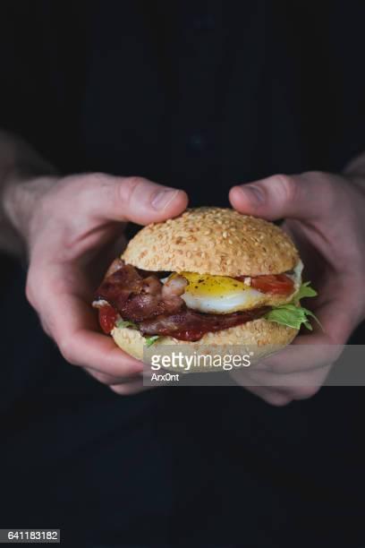 Tasty burger in hands
