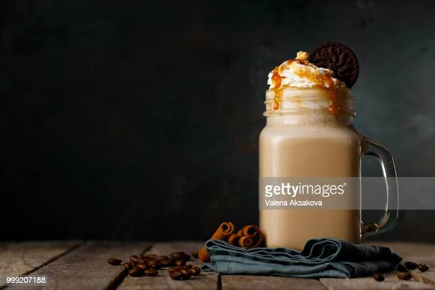 Tasty coffee drink in composition