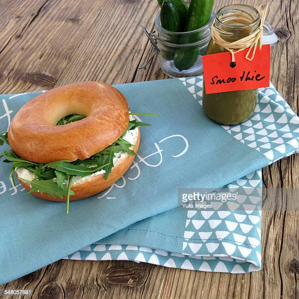 Tasty fresh bagel with cheese and salad