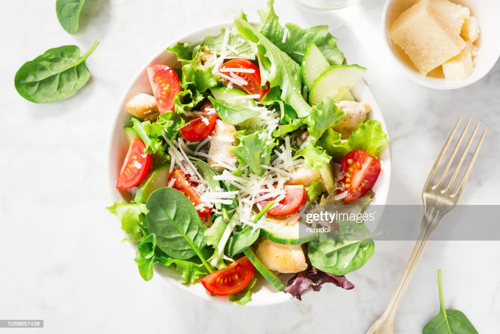 Tasty fresh salad with chicken and vegetables : Stock Photo