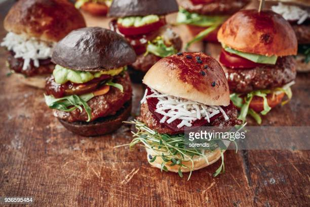 tasty mini burgers - food and drink industry stock pictures, royalty-free photos & images