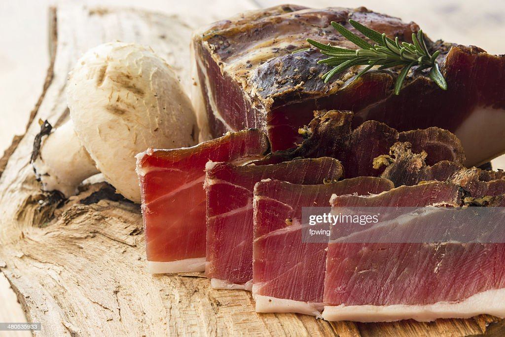 Tasty slices of Italian speck : Stock Photo