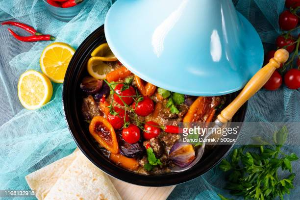 tasty spicy beef with various vegetables cooked in tagine - couscous marocain photos et images de collection