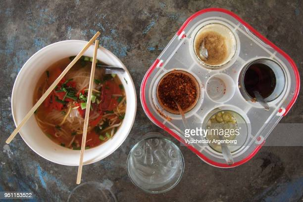 tasty thai noodle soup with traditional thai spices, khao sok, surat thani - argenberg bildbanksfoton och bilder