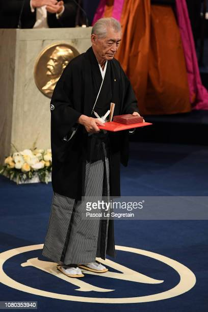 Tasuku Honjo laureate of the Nobel Prize in Physiology or Medicine acknowledges applause after he received his Nobel Prize from King Carl XVI Gustaf...