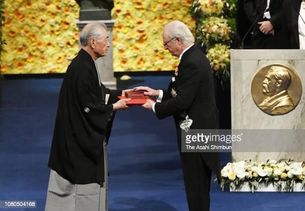 Tasuku Honjo, laureate of the Nobel Prize in Physiology or Medicine receives his Nobel Prize from King Carl XVI Gustaf of Sweden during the Nobel...