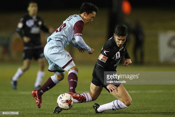 Tasuku Sekiya of APIA Leichhardt Tigers and Giorgio Speranza of Blacktown City compete for the ball during the round of 16 FFA Cup match between...