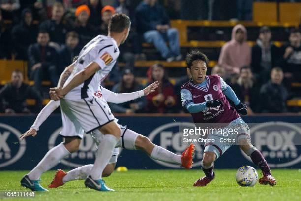 Tasuku Sekiya of Apia Leichhardt Tigers FC dribbles towards goal during the FFA Cup quarterfinal match between APIA Leichhardt Tigers FC and Adelaide...