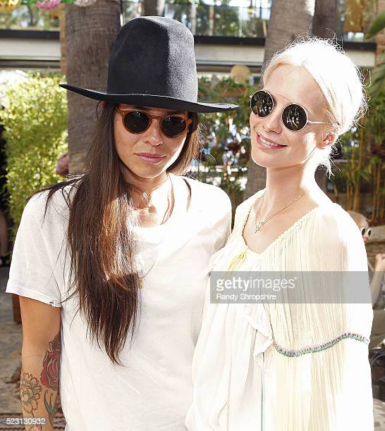 Tasya Van Ree and Poppy Delevingne attend the Villoid garden tea party hosted by Alexa Chung at the Hollywood Roosevelt Hotel on April 21 2016 in...