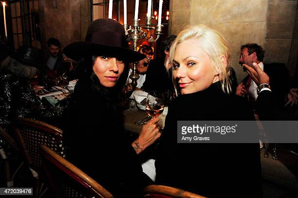 Tasya van Ree and Sydney Garrision attend the PHOTO Magazine Celebration of its Los Angeles Special Issue at the Chateau Marmont on May 2 2015 in...