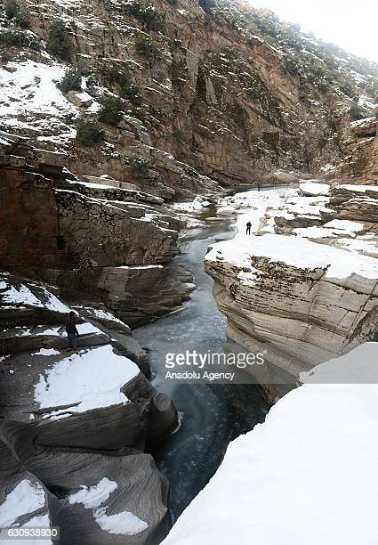 Tasyaran Valley is seen as two students take photos in Usak Turkey on January 04 2017 University students camp over the frozen part of Gediz River in...