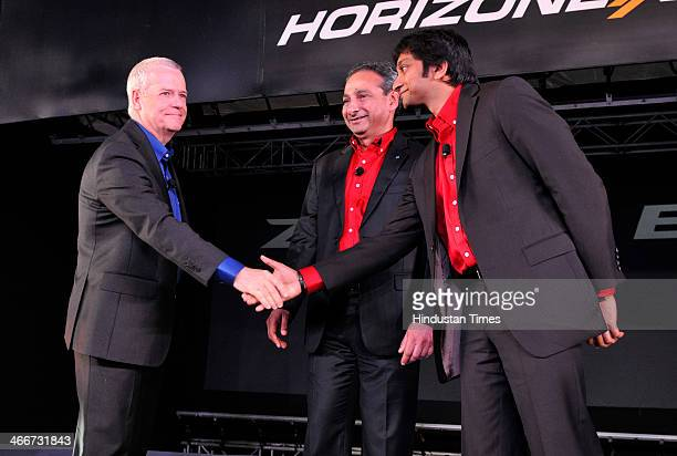 Tata Motors Head Of Research And Development Tim Leverton and Tata Motors Passenger Vehicles President Ranjit Yadav with Formula One driver Narain...