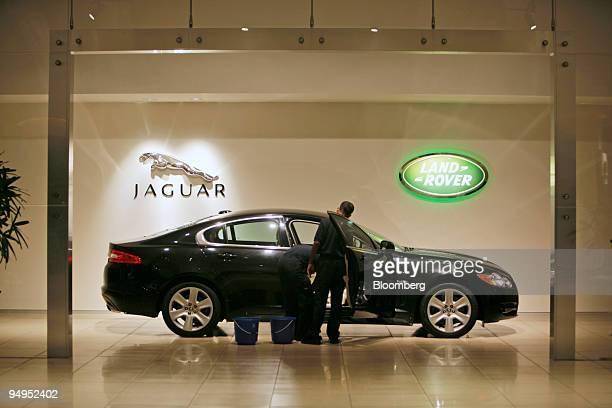 Tata Motors Ltd employee cleans a Jaguar model inside of the Jaguar Land Rover showroom in Mumbai India on Saturday Aug 29 2009 Tata Motors Ltd the...