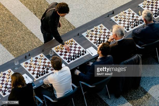 Tata Steel Chess Tournament winner Italian-American chess grandmaster Fabiano Caruana challenges politicians during his simultaneous chess match in...
