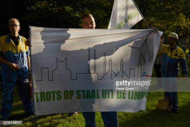 Tata Steel worker attends a rally prior to the Dutch parliamentary debate on the future of the steel plant on September 9, 2021 in The Hague,...