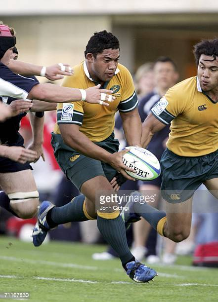 Tatafu PolotaNau of Australia is tackled by Ross Rennie during the IRB World U21 Rugby championship match between Australia and Scotland on June 9...