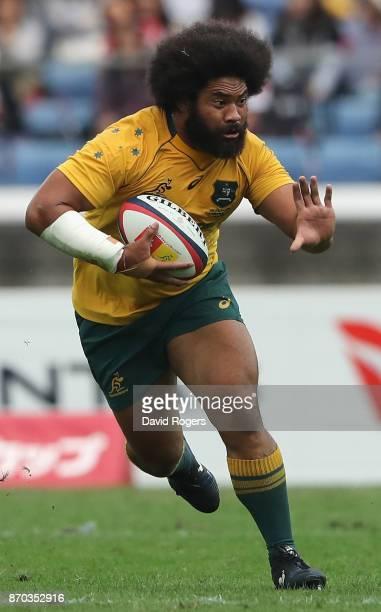 Tatafu PolotaNau of Australia runs with the ball during the rugby union international match between Japan and Australia Wallabies at Nissan Stadium...