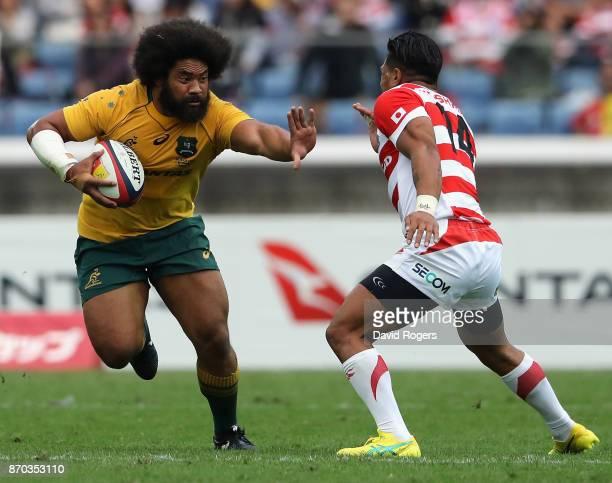 Tatafu PolotaNau of Australia takes on Lomano Lavu Lemeki during the rugby union international match between Japan and Australia Wallabies at Nissan...