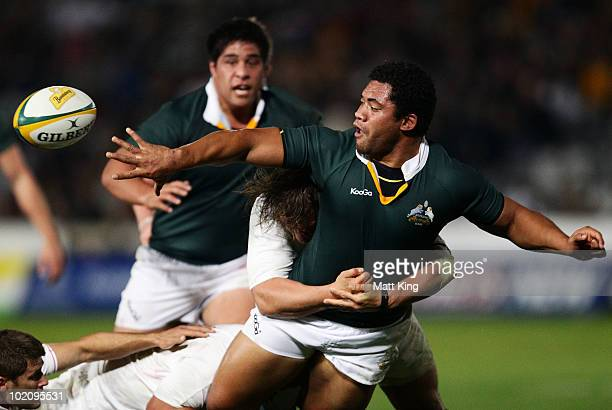 Tatafu PolotaNau of the Barbarians gets a pass away in a tackle during the match between the Australian Barbarians and England at Bluetongue Stadium...