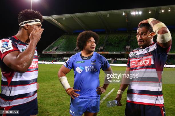Tatafu PolotaNau of the Force talks with Lopeti Timani and Amanaki Mafi of the Rebels during the round 16 Super Rugby match between the Force and the...