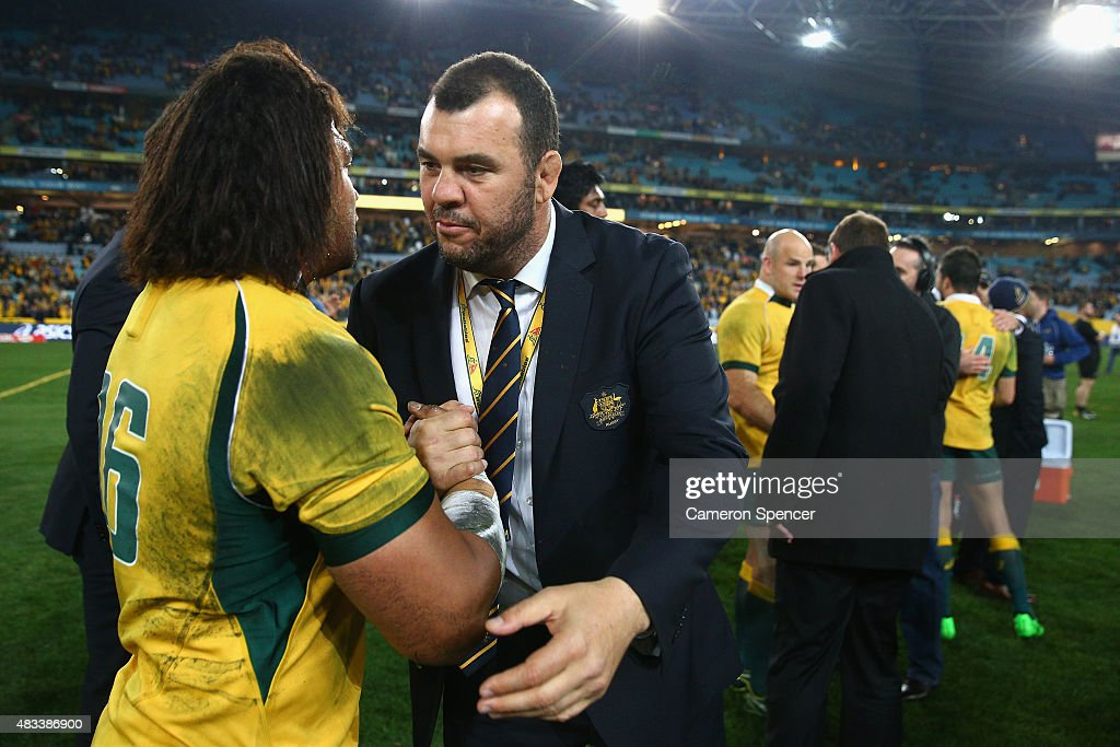 Tatafu Polota-Nau of the Wallabies is congratulated by Wallabies coach Michael Cheika after winning the Rugby Championship match between the Australia Wallabies and the New Zealand All Blacks at ANZ Stadium on August 8, 2015 in Sydney, Australia.