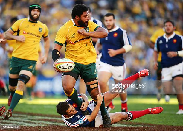 Tatafu PolotaNau of the Wallabies offloads the ball in a tackle during the International Test match between the Australian Wallabies and France at...
