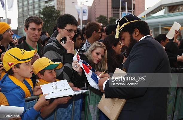 Tatafu PolotaNau of the Wallabies signs autographs during the Australian Wallabies IRB Rugby World Cup 2011 official team welcome ceremony at Aotea...