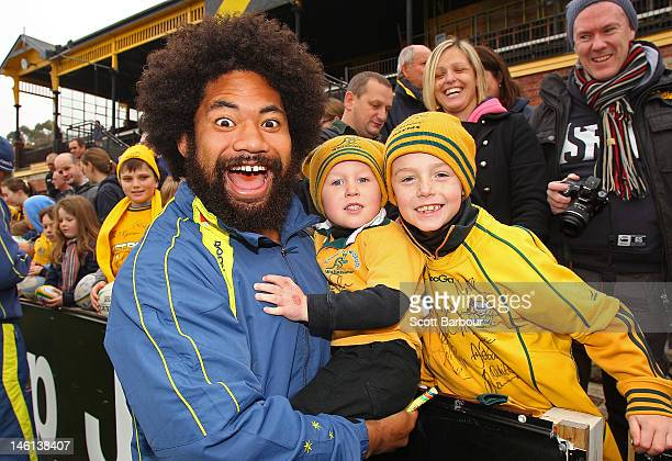 Tatafu PolotaNau of the Wallabies signs autographs for fans during an Australian Wallabies fan day at Punt Road Oval on June 11 2012 in Melbourne...
