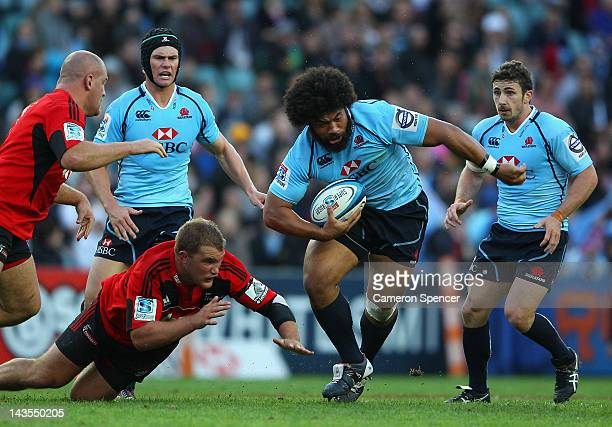 Tatafu PolotaNau of the Waratahs makes a break during the round 10 Super Rugby match between the Waratahs and the Crusaders at Allianz Stadium on...